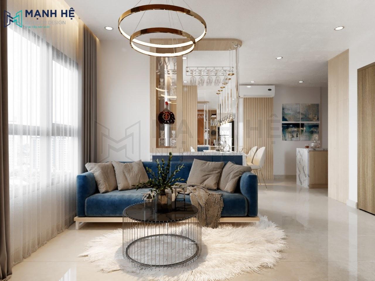 Ghế sofa bọc nhung màu xanh coban tạo điểm nhấn đặc biệt cho nội thất căn phòng khách bếp